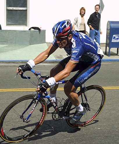 Lance Armstrong delivering some Express Mail with the U.S. Postal Mail box in the background!!